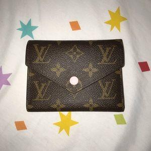Louis Vuitton Victorine wallet in monogram w/ pink